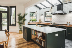 Dark-Green-Shaker-kitchen-with-kitchen-Island-including-a-bookeshelf-and-Carrera-Marble-island-worktop-and-Perrin-Rowe-Calisto-C-Sput-tap-finished-in-Polished-Brass-30