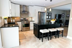 Sunlit Flooring Cabinetry and Counters